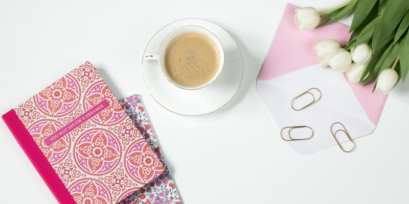 Flay Lay Image Of Pink Notebooks A Pink Envelope Paperclips White Tulips And A Cup Of Coffee
