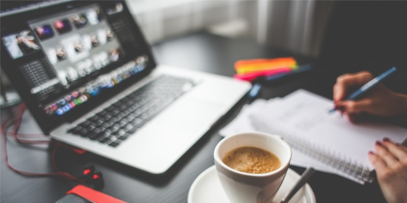 Bloggers Dark Desk With Laptop Coffee And Blogging Essentials For Business
