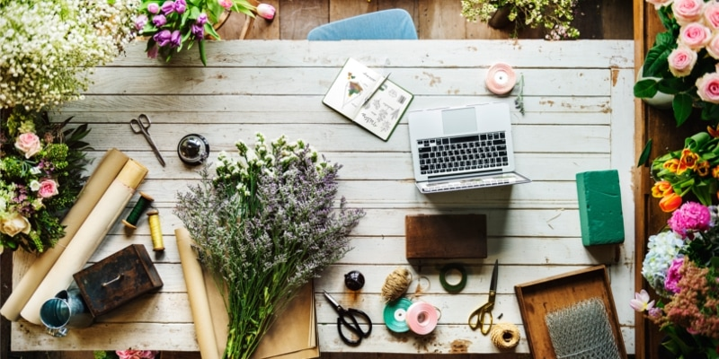 Craft Bloggers Desk With Laptop And Business Supplies