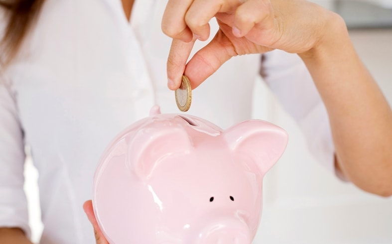 Blogger Making Money And Saving It Into Her Piggy Bank 1