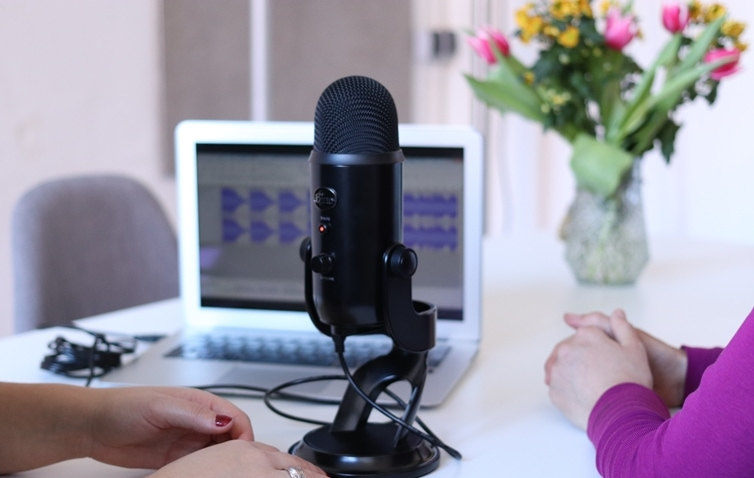 Bloggers Recording A Podcast To Make Money Blogging