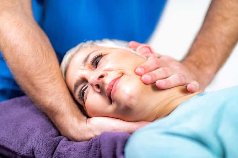 Physical Therapist Stretching Senior Woman's Neck in Billings