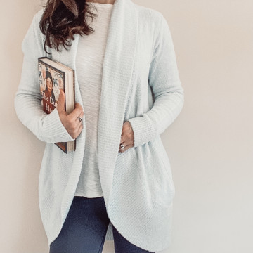 Barefoot Dreams cardigan sweater and book