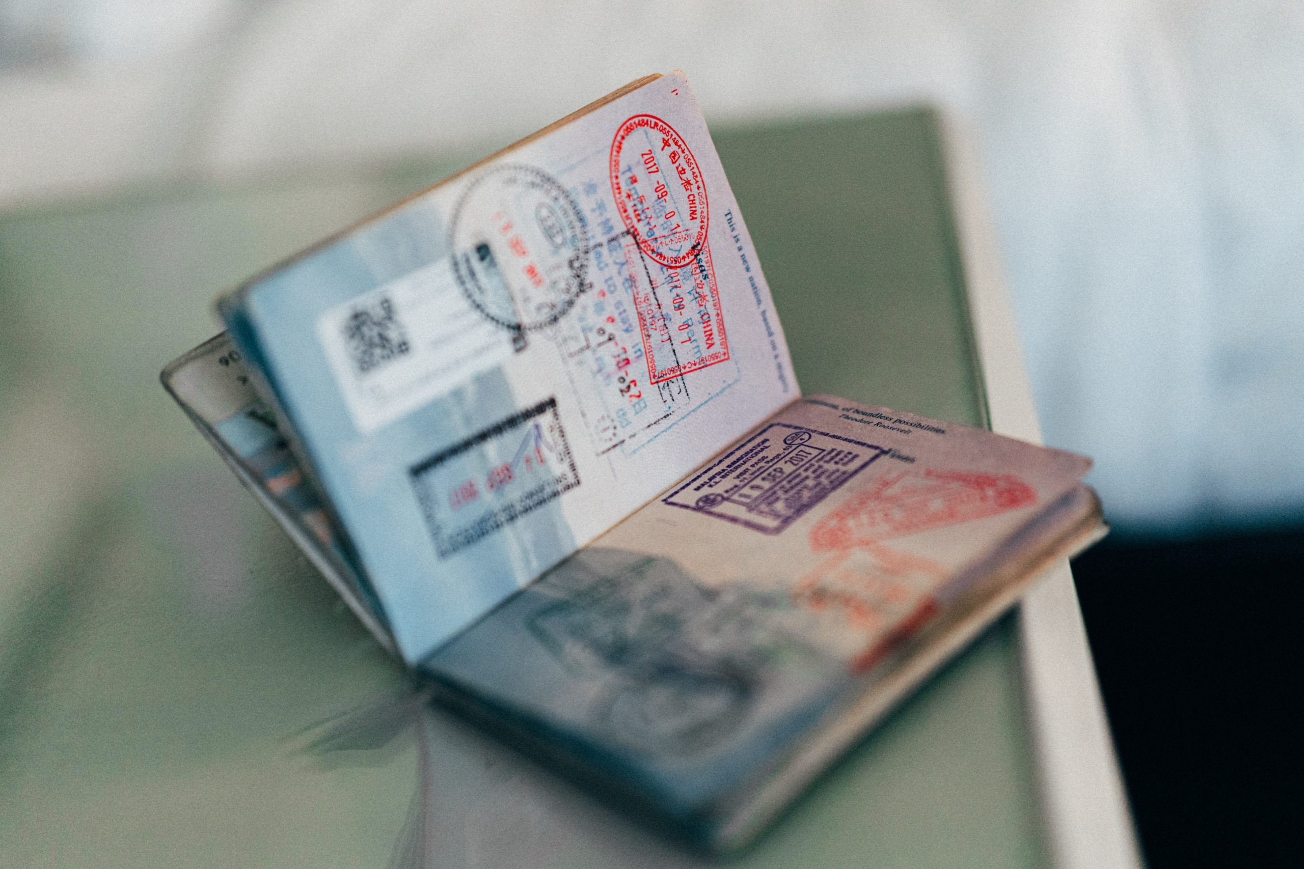 An image of an open passport book, which you need as a requirement for traveling to South Korea..