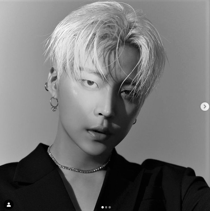 A photo of Joo Wondae, vocalist and guitarist of KPOP group WOW in black and white.