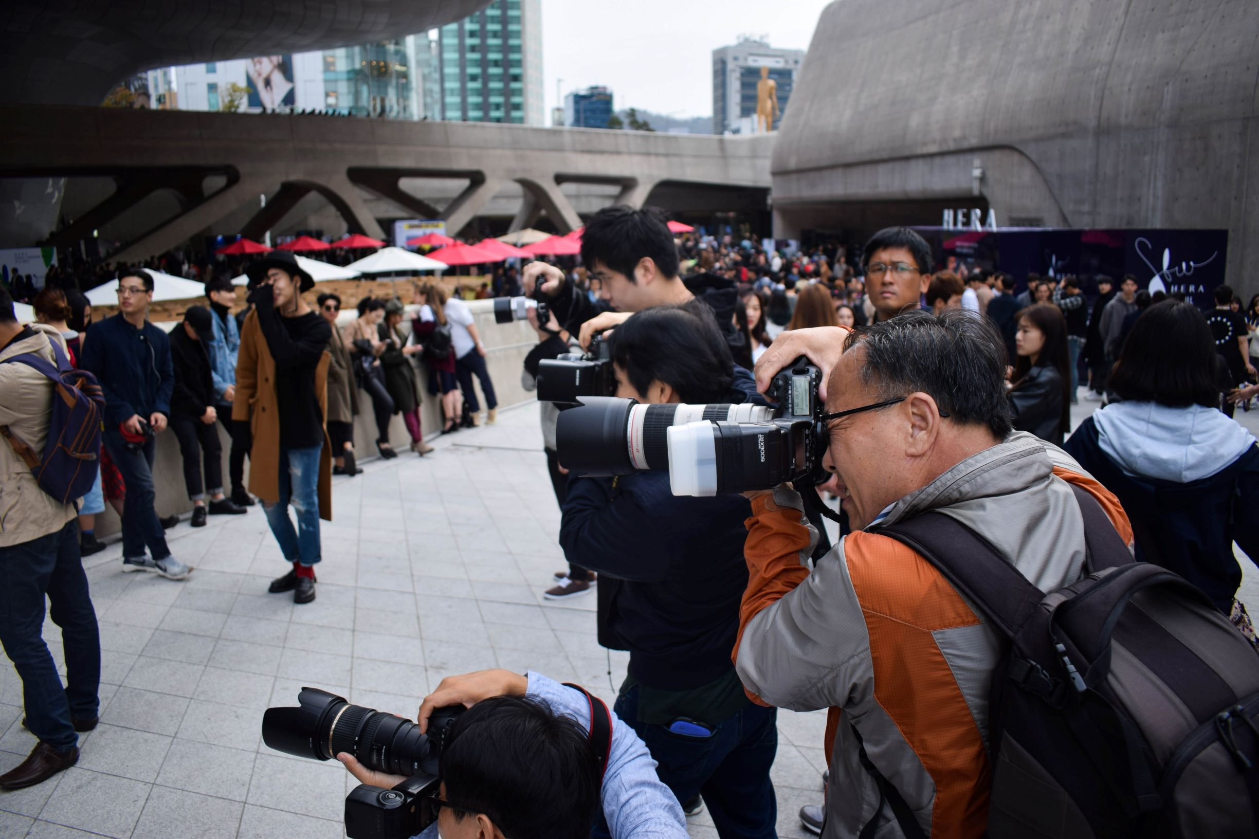 An image of photographers outside of Dongdaemun Design Plaza for SFW.