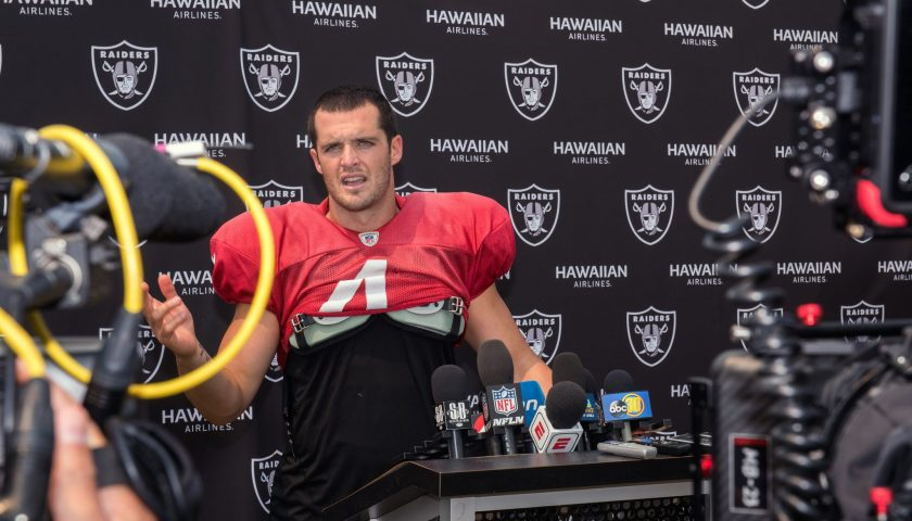 Oakland Raiders Quarterback Derek Carr speaks with the media after his practice in Napa Valley, Calif., August 7, 2018. U.S. Air Force photo by Louis Briscese via Creative Commons License.