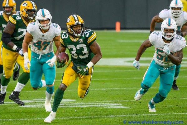Aaron Jones of the Green Bay Packers runs for a first down in a game against the Miami Dolphins at Lambeau Field, in Green Bay, Wisconsin on November 11, 2018. Photo Credit: Elvis Kennedy | Under Creative Commons License