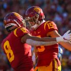 USC Trojans wide receiver Amon-Ra St. Brown (8) and Drake London celebrate after London's touchdown catch; UCLA at USC. November 23, 2019, Los Angeles, CA. Photo Credit: Steve Cheng | Under Creative Commons License
