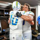 Justin Herbert and Rashawn Slater Celebrate After A Win In Washington. Photo Credit: Los Angeles Chargers On Twitter
