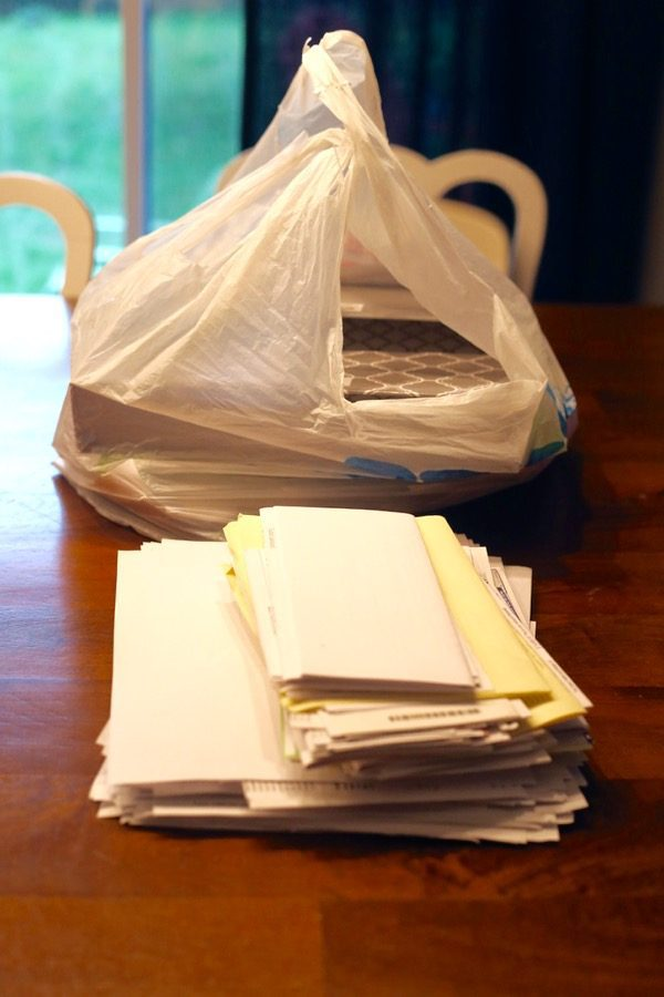 A stack of paper clutter on a table