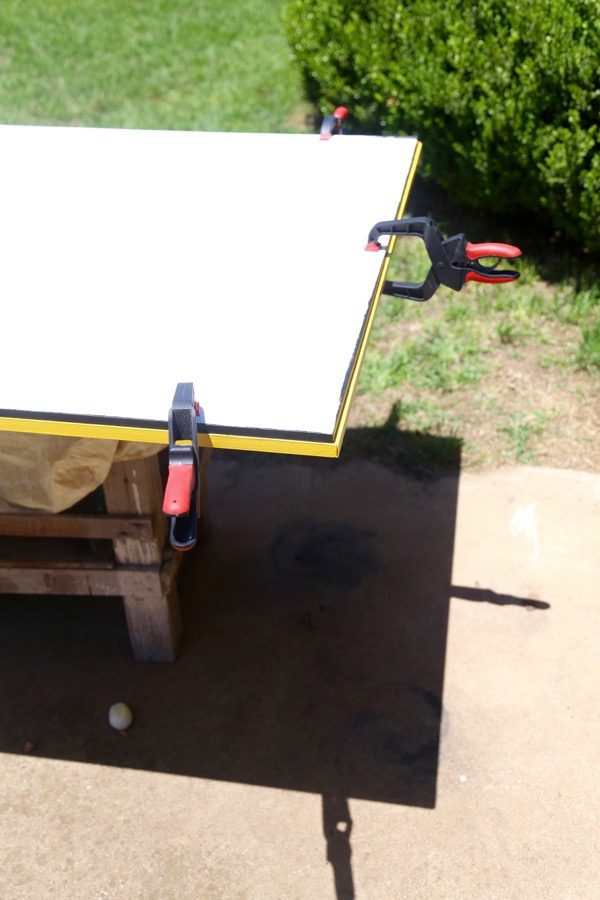 close up of assembly of DIY outdoor chalkboard