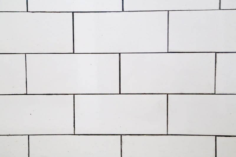This bathroom renovation is going to be amazing. The black and white tile in this room is so clean and modern! There are some great tips for tiling in this post, too. This One Room Challenge makeover is going to be absolutely amazing.