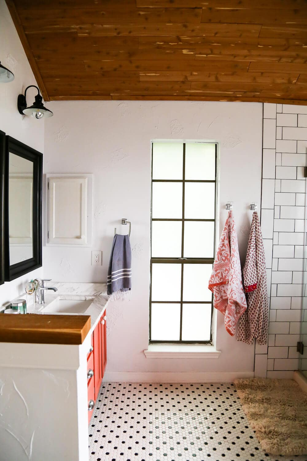 master bathroom DIY renovation - after photos of master bathroom with cedar planked ceiling and hex tiles