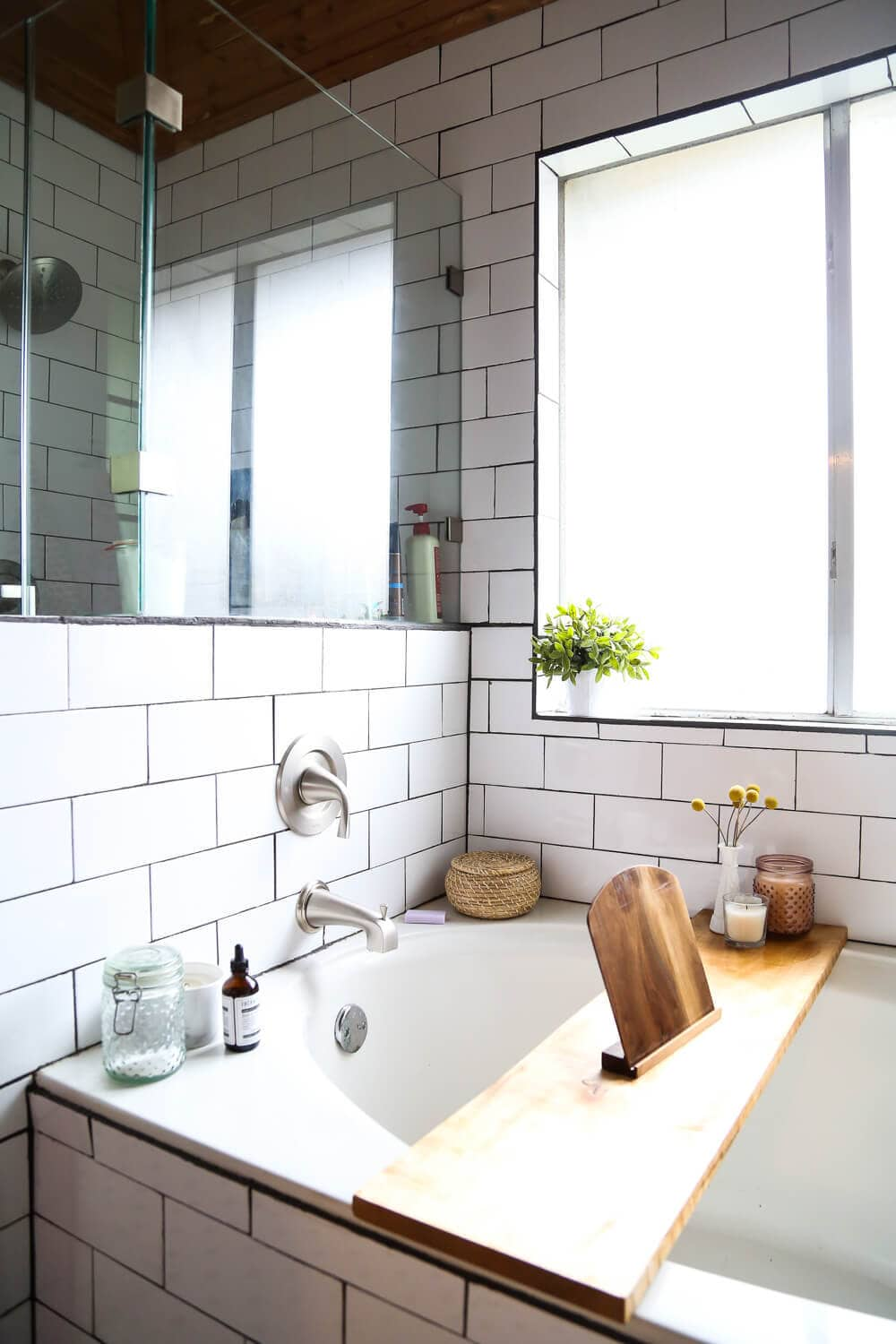 How to remodel a bathroom - ideas for a bathroom remodel with white subway tile, a large shower, and cedar planked ceiling