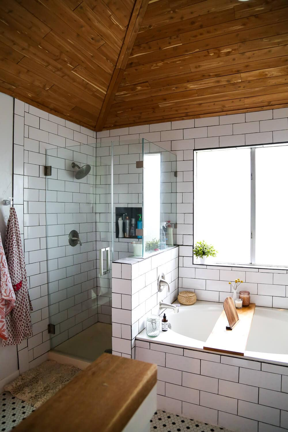 DIY master bathroom remodel - how to remodel a bathroom. A master bathroom with white subway tile, cedar-planked ceilings, and a glass shower