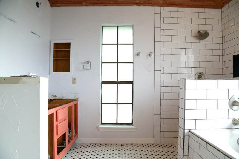 This master bathroom is so clean, bright, and serene! Love the black and white tile and the cedar planked ceiling!