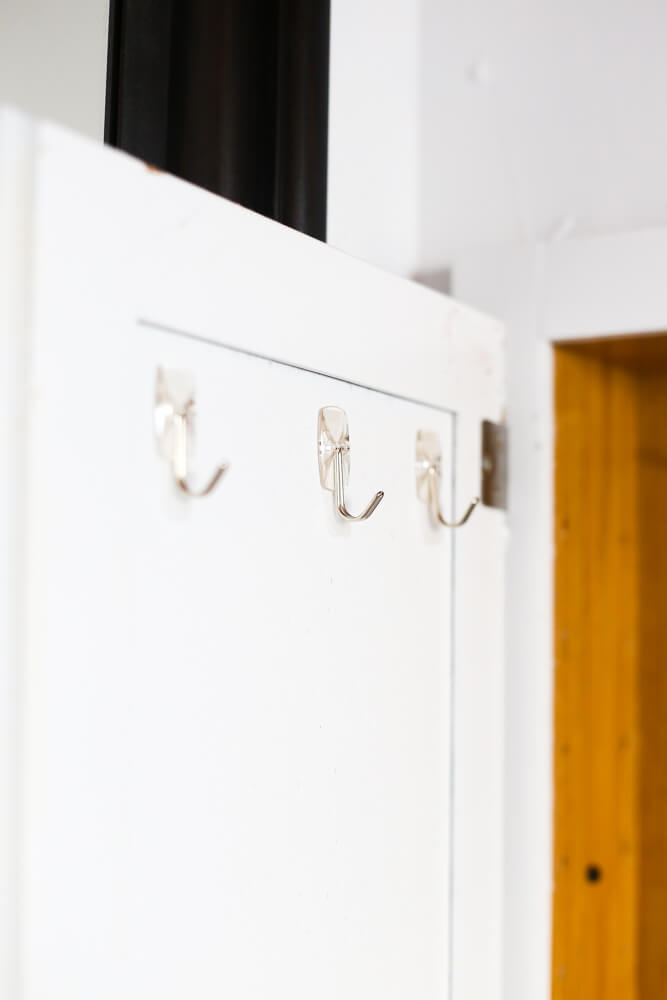 Command hooks in medicine cabinet