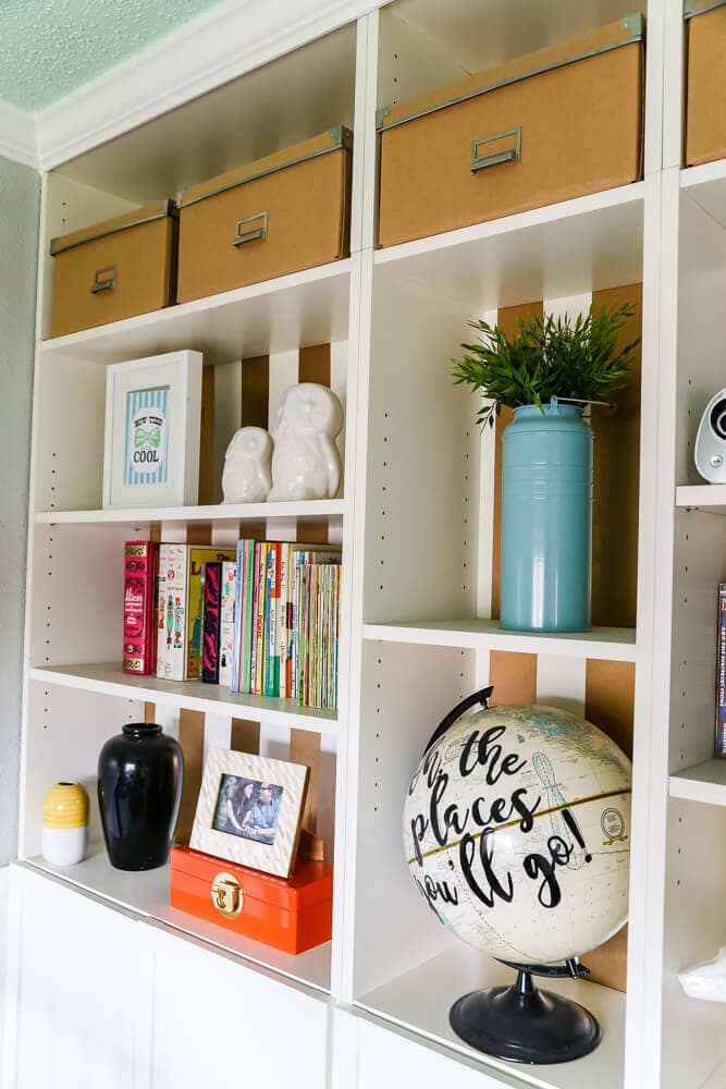 This gender-neutral nursery has a ton of great ideas for simple decor that will last through the toddler years. There's tons of storage for easy organization, and it has a very modern and sophisticated feel! Love it!
