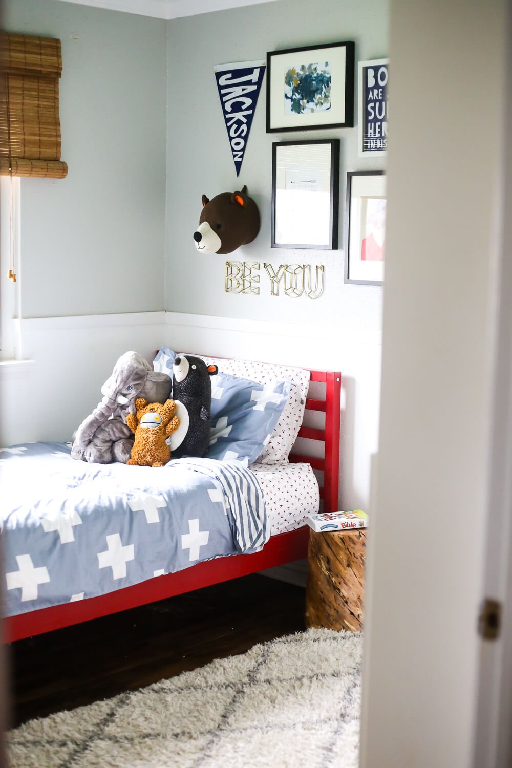 red painted bed in a gender-neutral toddler's bedroom - how to paint furniture
