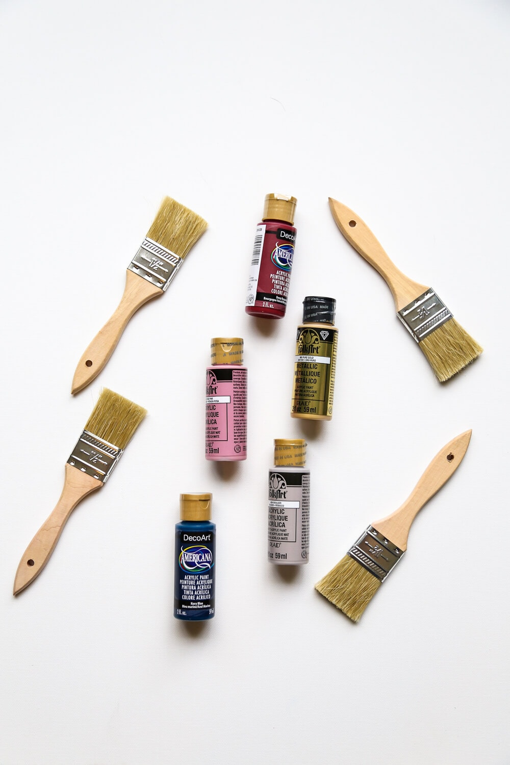 An assortment of paintbrushes and acrylic paints