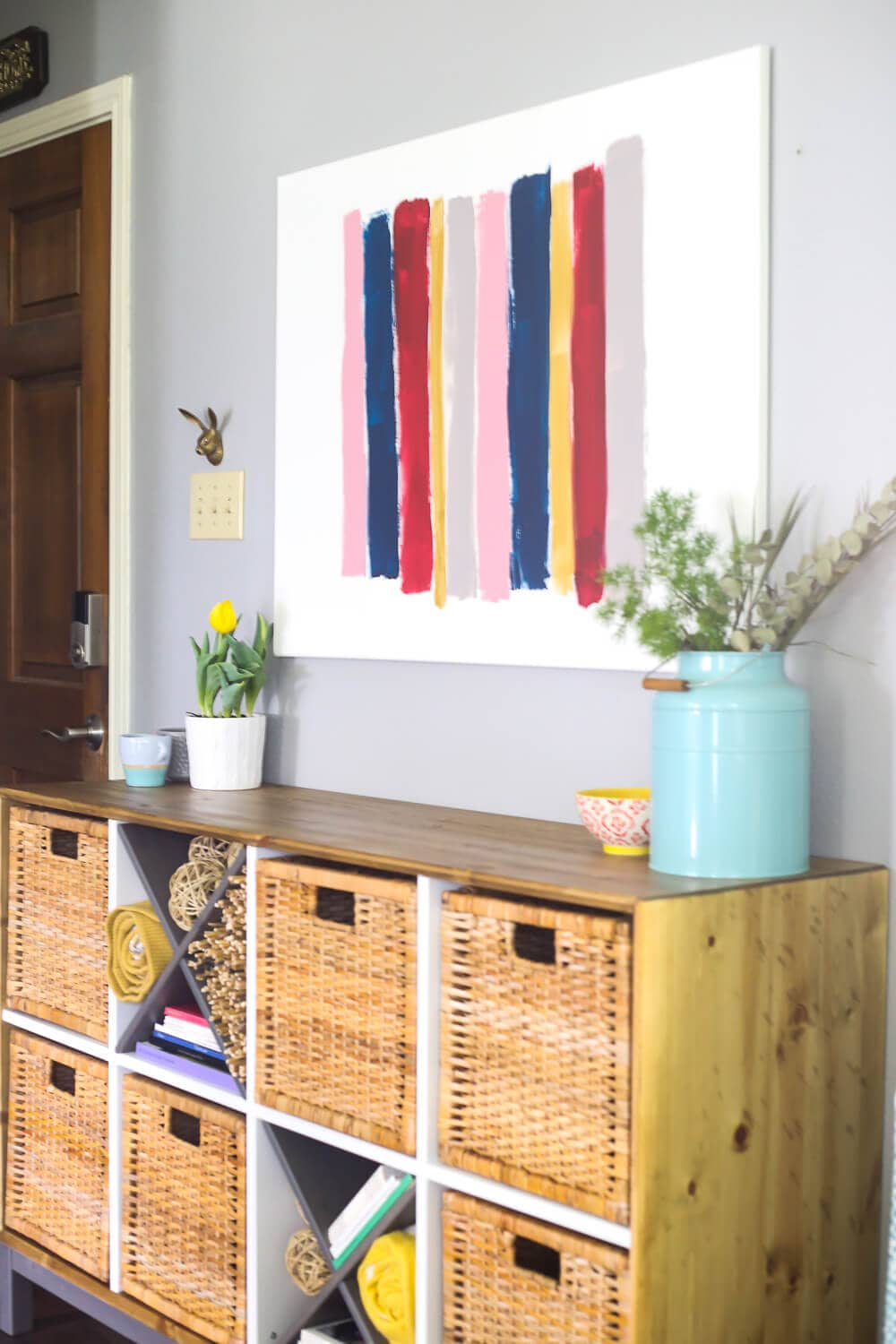 DIY canvas art - brush stroke art hung on a wall above a credenza