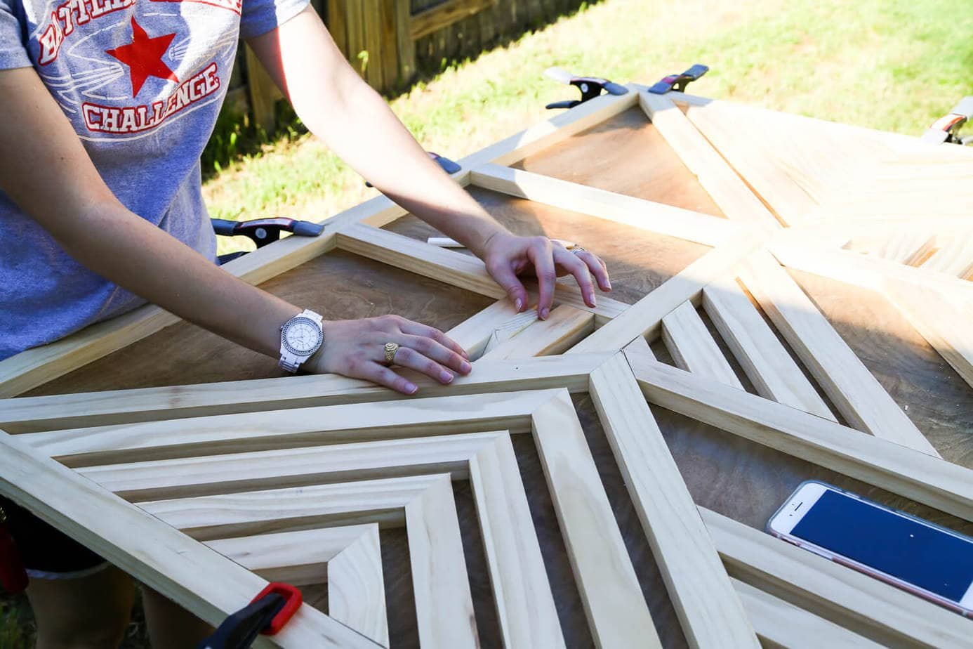 How to create a gorgeous large-scale wood wall art piece for your home. You just need some glue and a saw to cut it down! It's so easy that even a total beginner can do it, and it's absolutely gorgeous!