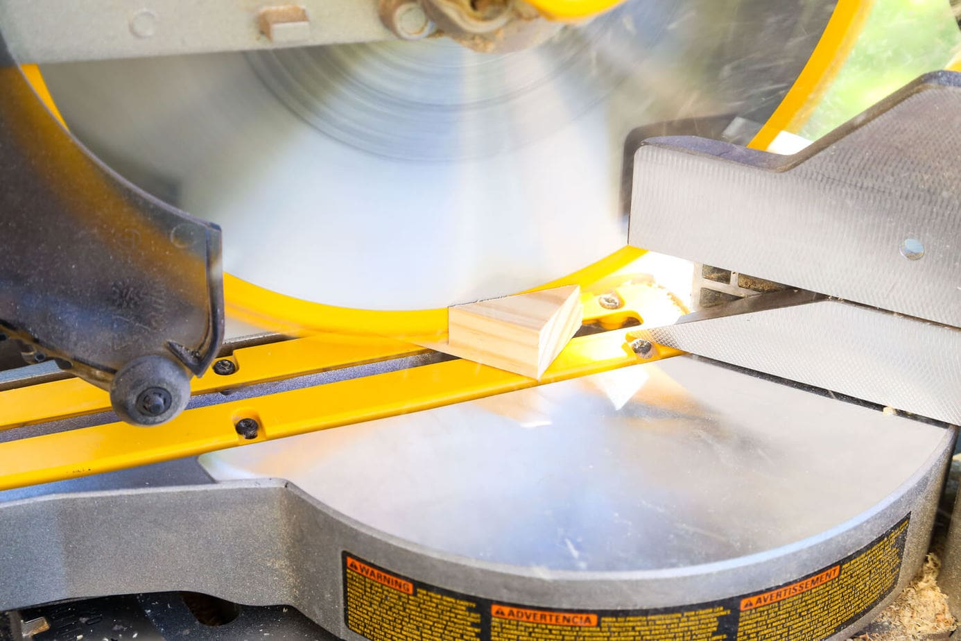 Close up of miter saw making a 45-degree cut