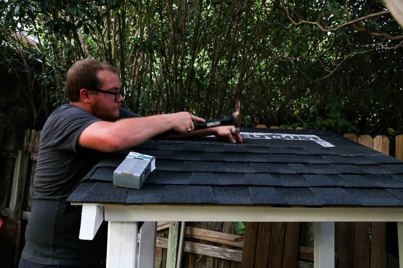 DIY installing shingles on a playhouse roof