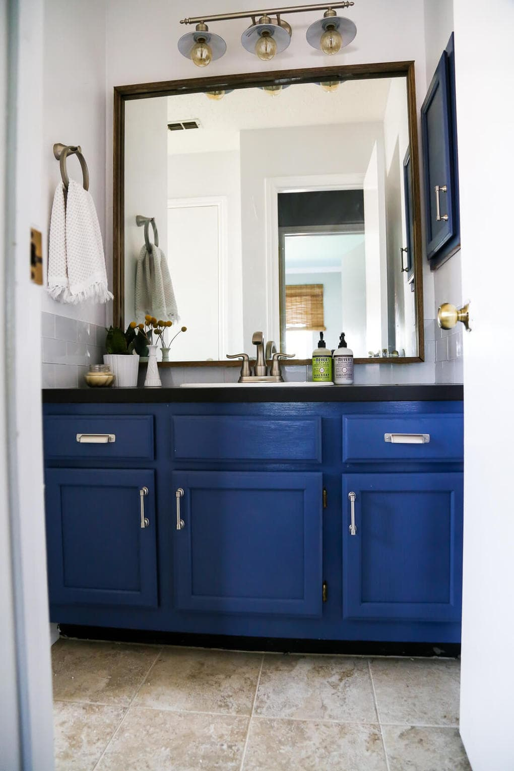 A DIY modern, serene bathroom renovation that can be completed in a weekend. Great ideas for how to upgrade an ugly bathroom and make it look like new without a ton of time or money.