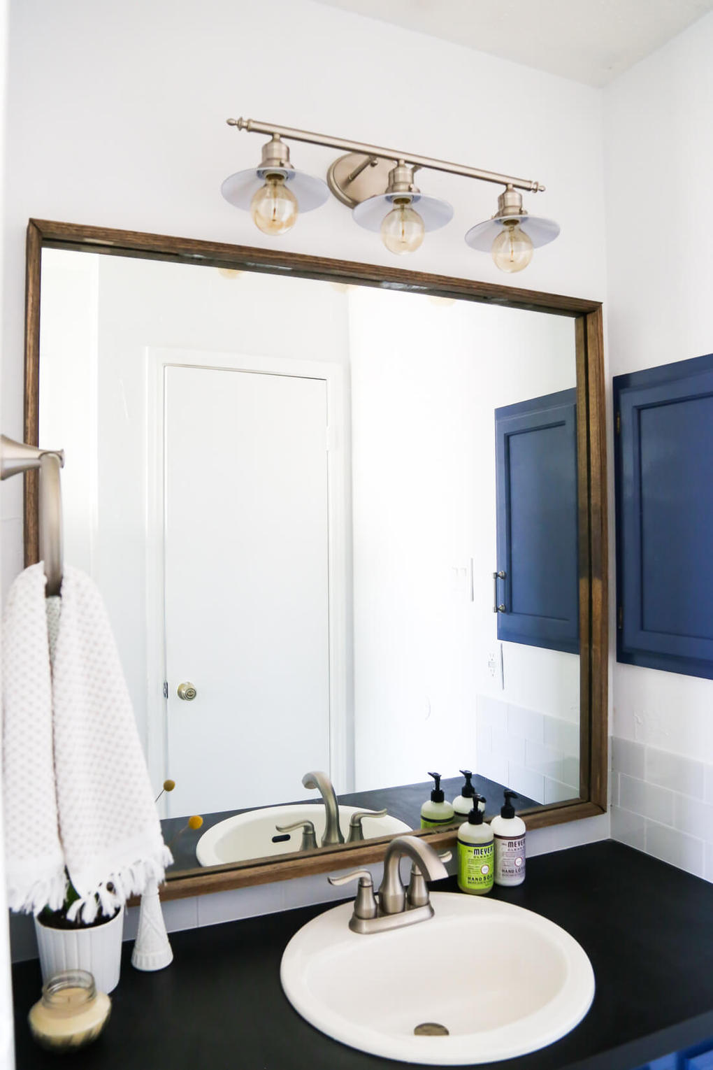 How to quickly and easily frame a bathroom mirror, to take your bathroom from builder-grade to completely custom!