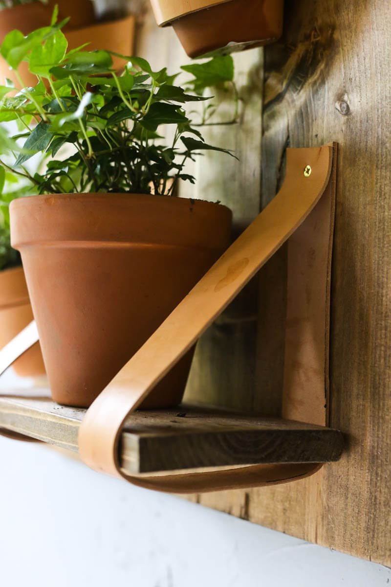 How to hang shelves using leather straps