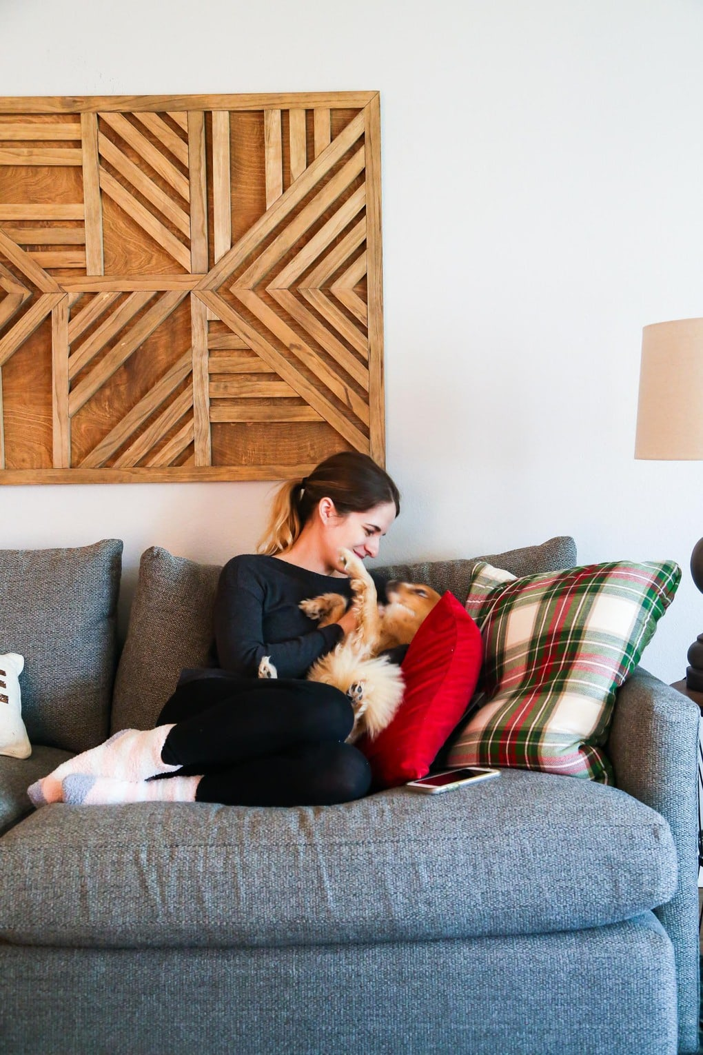 Woman on couch with dog - tips for moving and selling a home