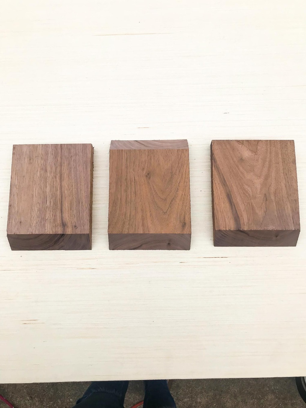 Three pieces of wood to be used to create sofa arm table
