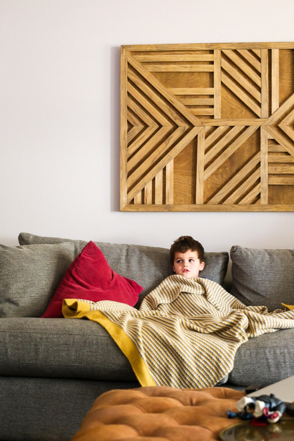 young child on couch - tips for how to enjoy winter, even when you're ready for spring