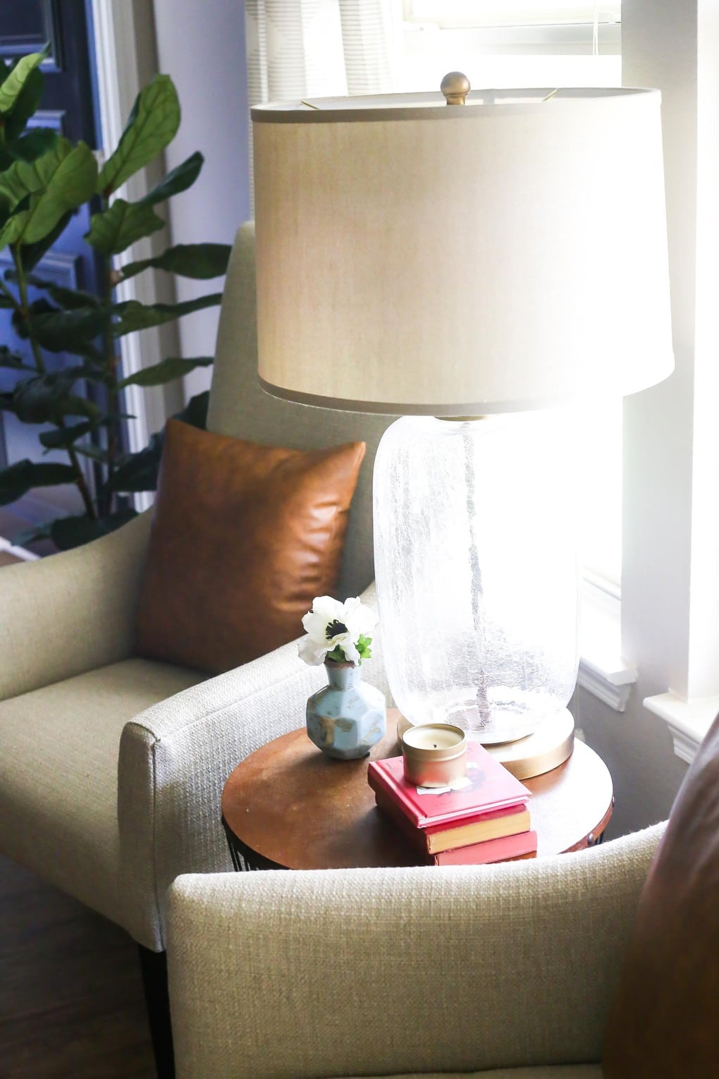Glass table lamp and white chair