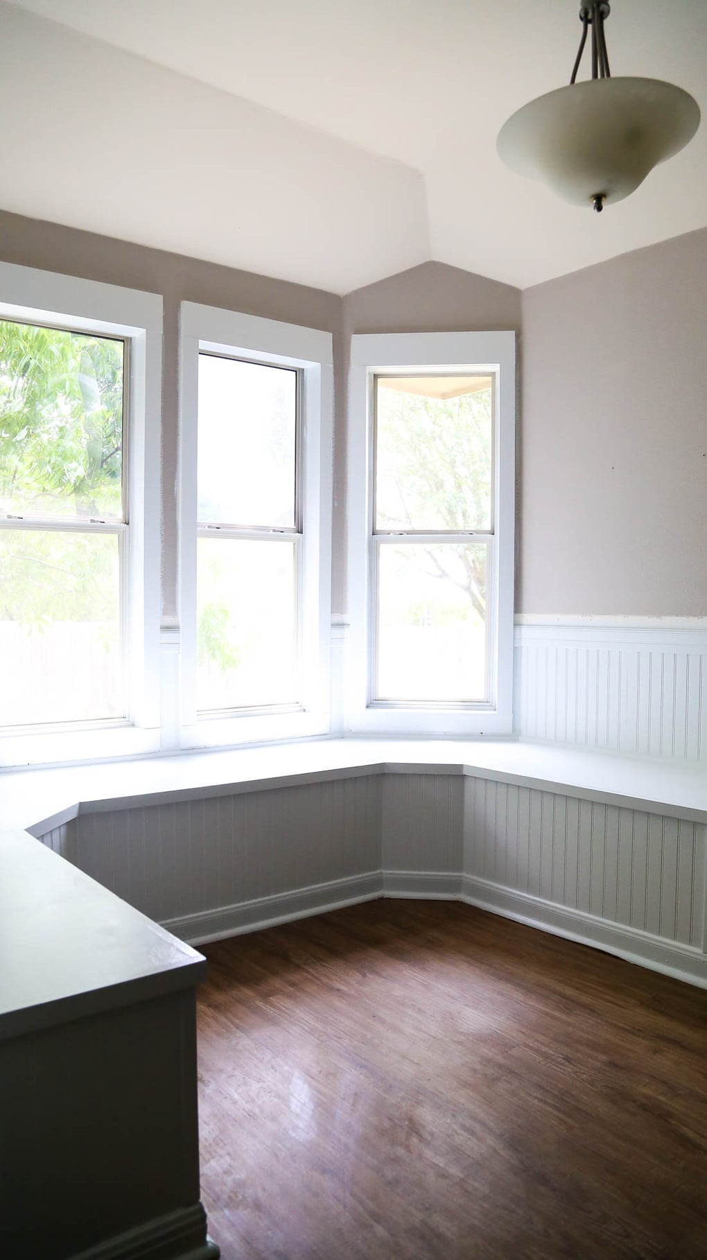 Bay window seating in a small dining nook