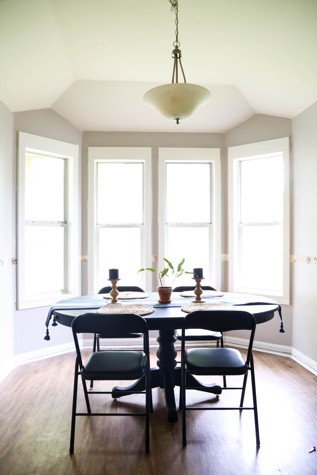 DIY window trim in bay window of dining room