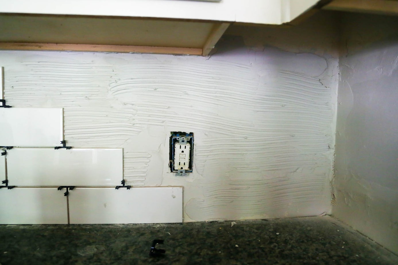 How to install a subway tile backsplash in your kitchen - applying thinset