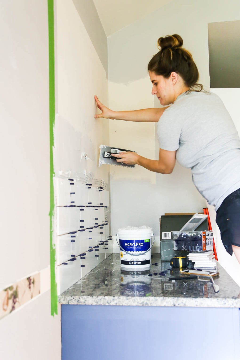 Tiling kitchen wall