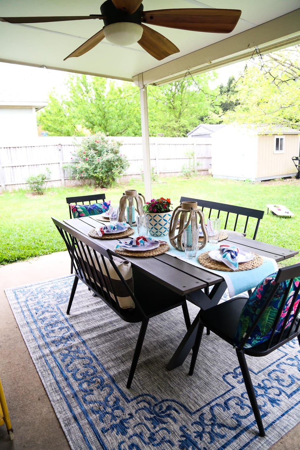 Back patio with a table, two benches, and two chairs