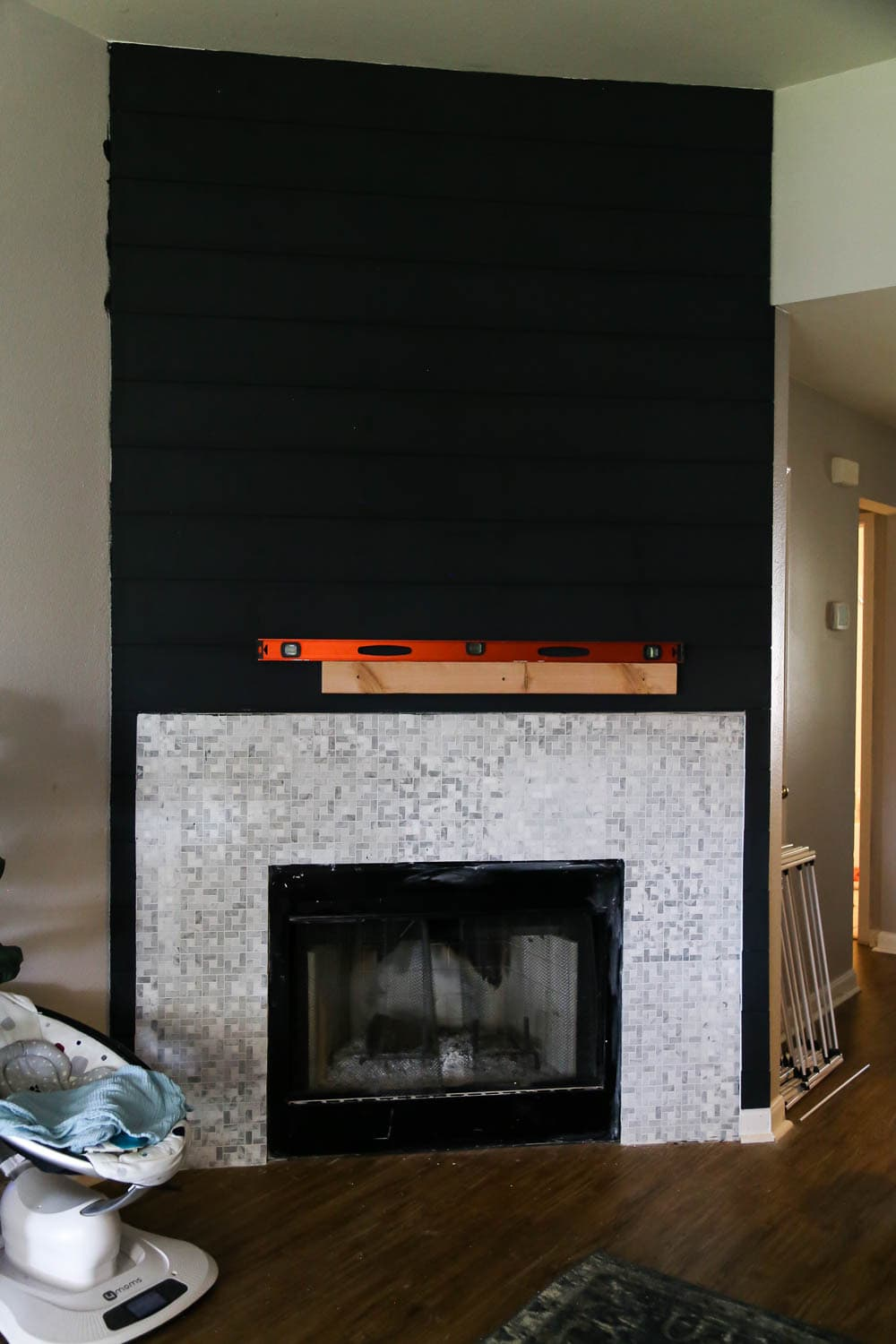 hanging a DIY fireplace mantel