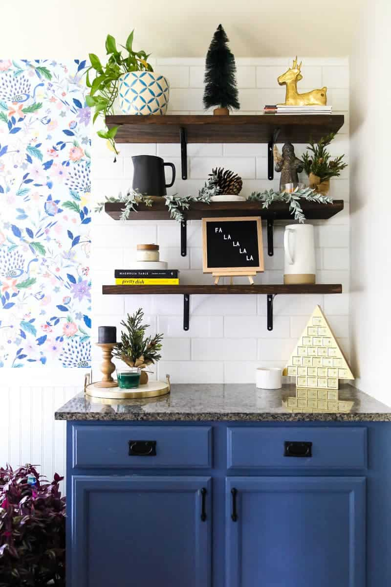 kitchen open shelving decorated for Christmas