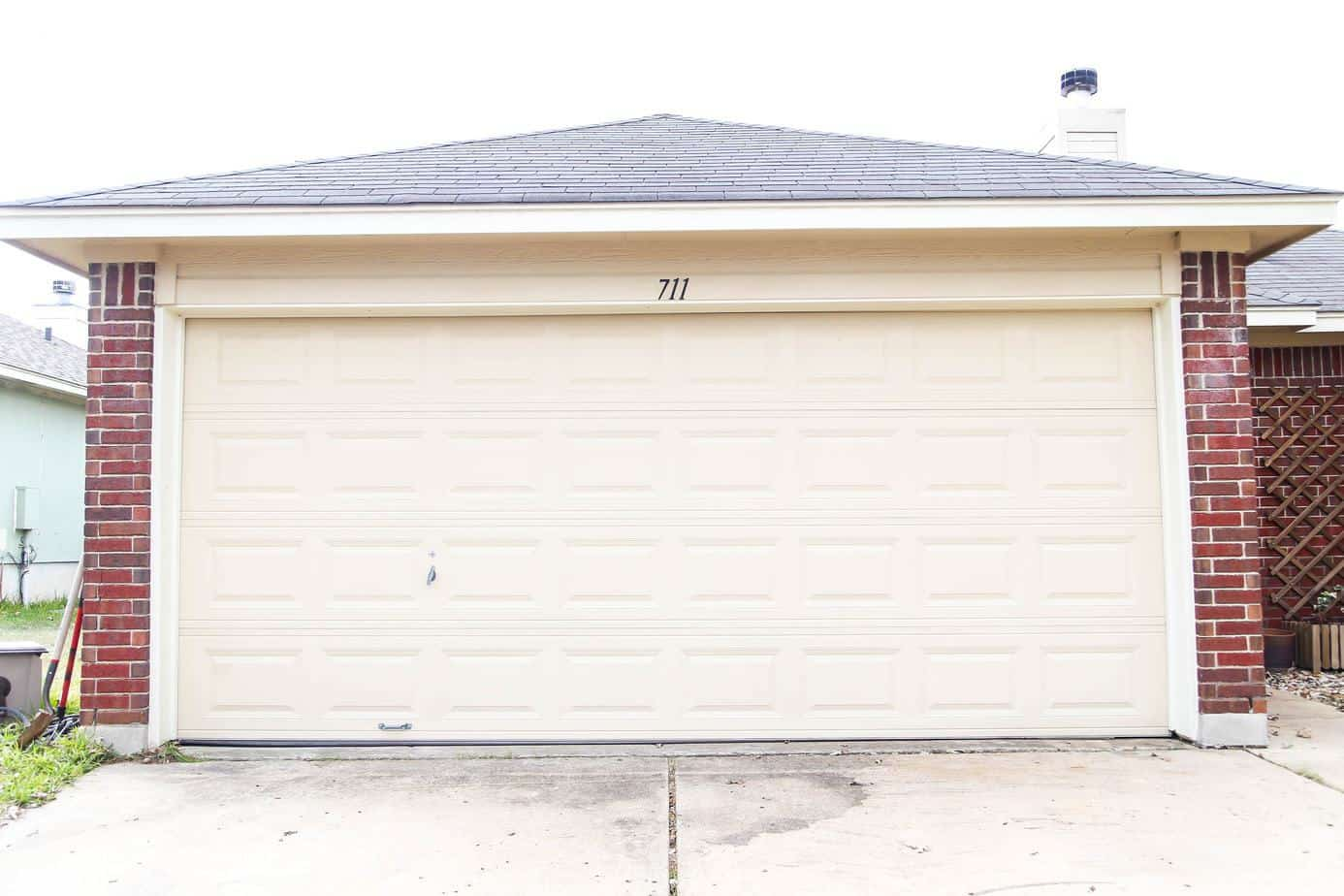 Garage door makeover before