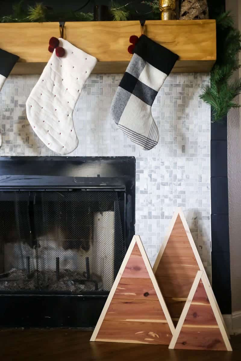 Fireplace with three cedar planked trees in front