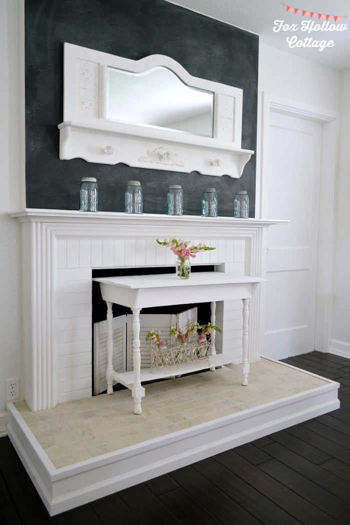 faux fireplace makeover with chalkboard wall