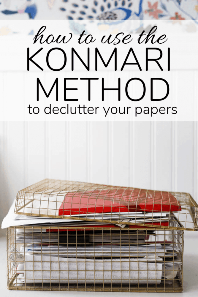 """box of paper with text overlay - """"how to use the konmari method to declutter your papers"""""""
