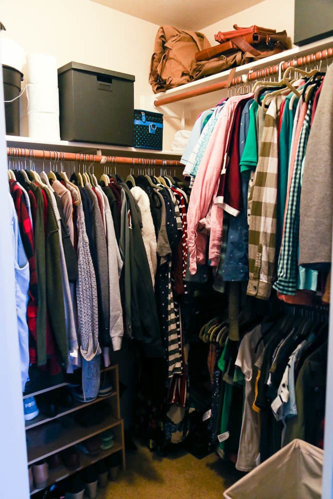 closet with clothing hanging on racks