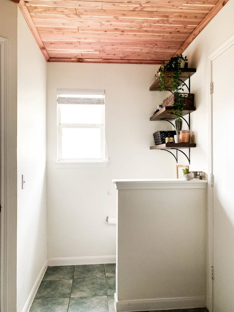bright and airy bathroom with cedar lined ceiling