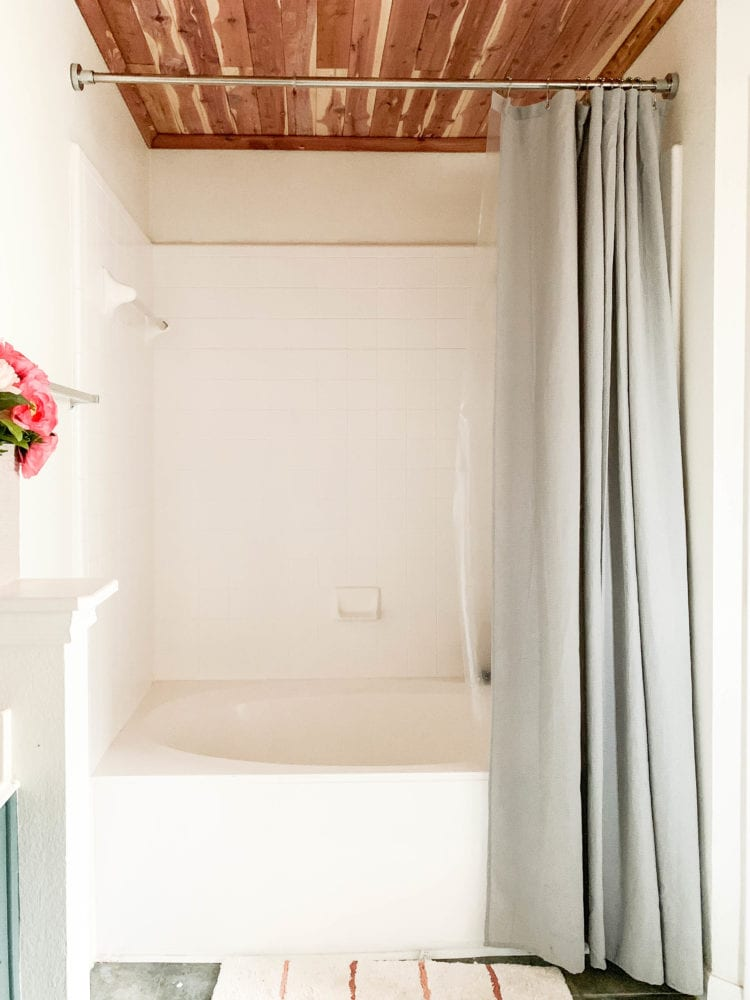 shower and tub area with cedar lined ceiling